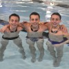 Triplets Bond Through Swimming