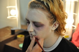 Junior Mykayla Orner gets her makeup done before the show.