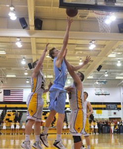 Lucas Jones shoots a layup.  Photo by Maddie Schoemann