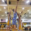 Sophomore Lucas Jones goes in for the layup.  Photo by Maddie Schoemann