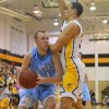 Senior Zach Schnieder is guarded tightly by a West player.  Photo by Maddie Schoemann