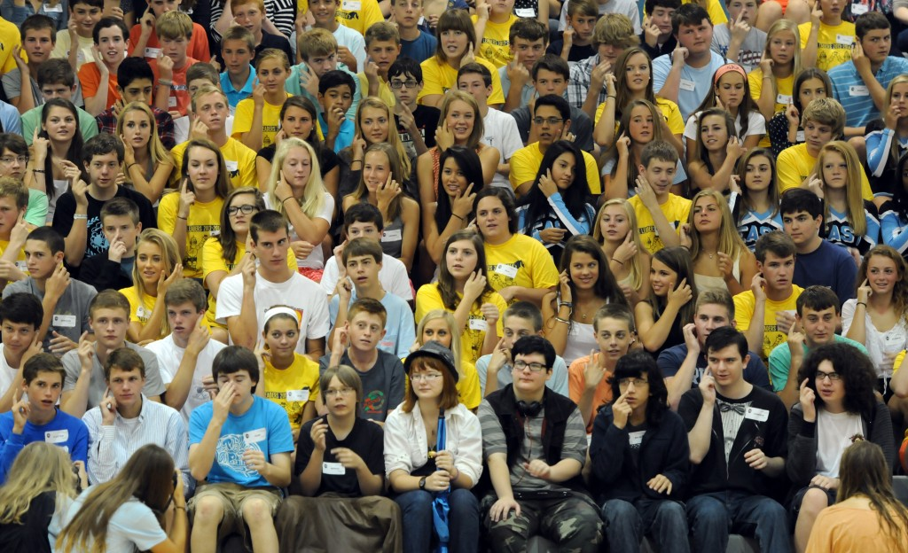 Link Crew Leaders and freshmen participate in warm up exercises before starting the day. Photo by Mckenzie Swanson