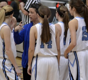 Jv coach Julie Sparks gives the girls a pep talk during a time out. Photo by Kaitlyn Stratman
