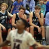 Varsity Senior Boys sit out for the final seconds of their last high school basketball game. Photo by Hailey Hughes