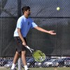 Junior Bhavish Dinakar tosses the ball up in preparation for his last serve. Photo by Kaitlyn Stratman