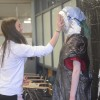Junior Brooke Erickson pies Natalie Kaufmann. Pieing people is an annual tradition for pi day by the IB HL classes. Photo by Kylie Rellihan