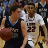 Senior Gunnar Englund dribbles by Lawrence's John Barbee. Photo by James Wooldridge