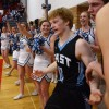 Cheerleaders cheer for senior Jack Flint after hustling for the ball sent him to the floor at their feet. Photo by James Wooldridge