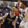 Senior Jack Flint drives by junior Justin Roberts. Flint had nine points. Photo by James Wooldridge