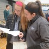 Junior Emma Olander and Sophomore Rebecca Sheridan work on an Earth Fair scavenger hunt. Photo by Kylie Rellihan