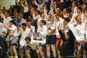 The student section errupts as Junior Davis Morrison knocks down a three-pointer to give the Lancers the lead. Photo by Joseph Cline