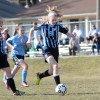 Sophomore Lily Flint dribbles towards the goal. Photo by Joseph Cline