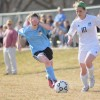 Junior Adalaide Kline fights for possession of the ball. Photo by Joseph Cline
