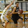 Senior Gunnar Englund charges past a Raiders defender into the lane. Photo by Joseph Cline