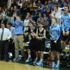 The Lancers on the sidelines celebrate after a basket. Photo by Katie Lamar