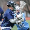 Junior Henry Redmond locks off an opposing player while the Lancers are down a man. Photo by Callie McPhail