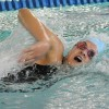 Freshman Annie Jones swims the 100 yard freestyle. Photo by Haley Bell