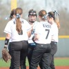The infield gathers after warmups for a pep talk before the game starts. Photo by Kylie Rellihan