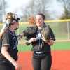 Senior Hannah Nick gets congratulated by her teammate after catching a line drive. Photo by Kylie Rellihan