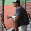Head coach Chip Ufford watches the team fielding during the fourth inning. Photo by Kylie Rellihan