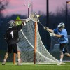 Senior and goalie Jack Werner passes the ball to the a teammate on offense. Photo by Katie Lamar