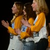 "Freshmen Isabel Fimbres, Lauren Davis, and Sydney Horton clap to the beat while singing ""One Love"".  Photo by Abby Blake"
