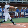 Senior Sam Williams swings while the Blue Jays watch from the dugout. Photo by James Wooldridge