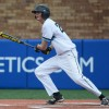 Sophomore Zeb Vermillion hits a single up the middle. Photo by James Wooldridge
