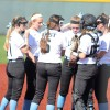 "The infield huddles before the second inning. ""We normally huddle before each game to encourage everyone before each inning,"" said sophomore Brooklyn Walters. Photo by Kylie Rellihan"