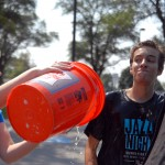 Junior Coleman Brockmeier gives senior Elaine Chamberlain an annoyed glance after she dumped a bucket of water on him. Photo by Tess Iler