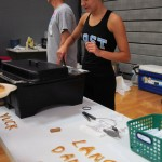 Sophomore Emma Renwick serves sausages to the supporters. Photo by Katie Lamar