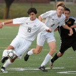 Seniors Andrew Mulligan and George Colby defend the ball against West. Photo by Morgan Browning
