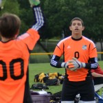 Freshman goalies, Brandon McGaugh and Jack Lischer, warm up their arms during halftime. Photo by Kaitlyn Stratman