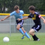 Freshman Cale Mueller out-sprints his opponent to the ball. Photo by Kaitlyn Stratman