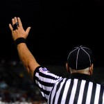 The referee calls a fumble. Photo by Maddie Smiley