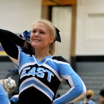Sophomore Lauren Packer dances to the bands music with the cheer squad. Photo by Maddie Smiley