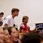 Freshman Hudson Churchill and Charlie Colby chant along with the crowd. Photo by Maddie Smiley