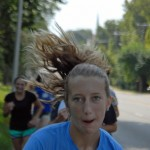 Sophomore Julia Kapros charges up the last hill of the run.  Photo by Tess Iler