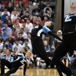 Sophomore Payton Lieb jumps into the air during the varsity Lancer Dancer dance. Photo by Ellie Thoma