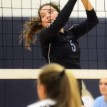 Junior Kaitlyn Stratton goes up for a block as the other team passes it over the net. Photo by Morgan Browning