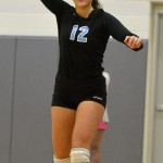 Junior Claire Pottenger laughs while throwing the ball to her teammate during warm-ups. Photo by Abby Blake