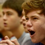 Senior Baker Stradinger reacts to a cheerleader slipping at the top of the pyramid. Photo by Joseph Cline