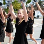 "The JV Lancer Dancers walk down in the parade, dressed for the theme of ""Breakfast at Tiffany's"". Photo by Morgan Browning"