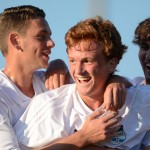 With 2 mins left in regular time, sophomore Tommy Nelson scores the equalizer and is congratulated by seniors Cody Luenz and Andrew Mulligan. Photo by Joseph Cline