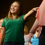 "Junior Kylie Ledford dances during the last song of the dress rehearsal, ""Life is a Highway"". Photo by Morgan Browning"