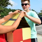 Student body president Kyle Baker builds a part of the senior Harry Potter float with senior Isabelle Burk. Photo by Diana Percy