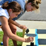 Seniors Maddie Wilson and Bonnie Longan help paint the senior float. Photo by Diana Percy