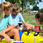 Freshman Addie Vondrehle, Meg Thoma, and Annabelle Cook paint minions for the freshman float. Photo by Diana Percy