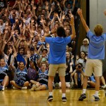 Seniors Andrew Stottle and George Colby demonstrate the rollercoaster cheer in front of the senior section. Photo by Diana Percy