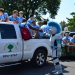 The Lancer mascot high fives football players in the SME parking lot before the floats leave. Photo by Diana Percy
